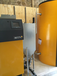 Biomass boiler and water tank during installation