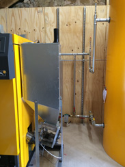 Biomass boiler fuel hopper and pipework