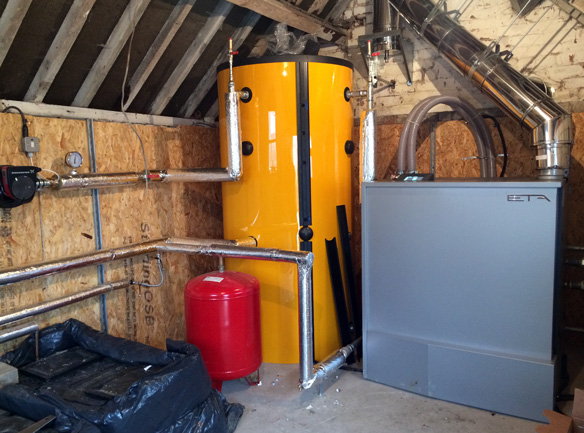 Biomass pellet boiler and buffer tank installation