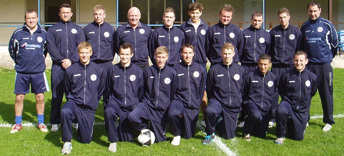 Llangollen Football Club team in their tracksuits sponsored by Worcester Bosch and AW Renewables Ltd
